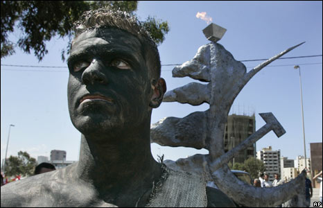 Lebanese man covered in black paint
