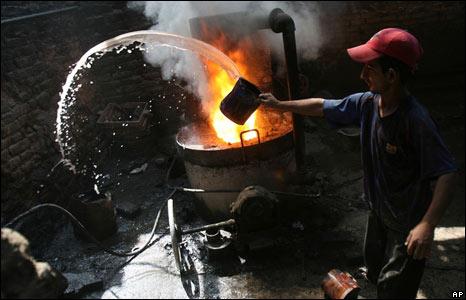 Iraqi man throwing water at furnace
