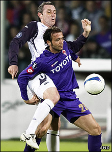 David Weir and Giampaolo Pazzini tussle for the ball