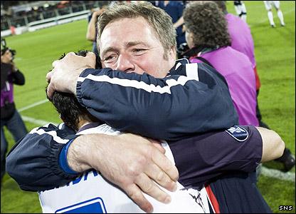 Ally McCoist hugs Brahim Hemdani