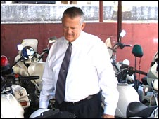 Deputy Commissioner Michael O'Neil inspects the force's bike fleet