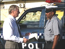 Commissioner Gary Nelson talks with an Antiguan police corporal