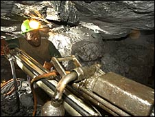 Miner using a drill in a South African mine owned by AngloGold Ashanti