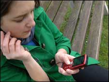 Woman watching TV on a mobile, BBC