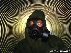 Man in mask in a bunker