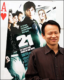 Yuchun Lee with poster advertising the film 21
