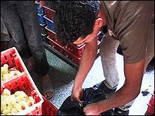 Raed Abu Ajwah, a Gaza farmer, suffocates his chicks