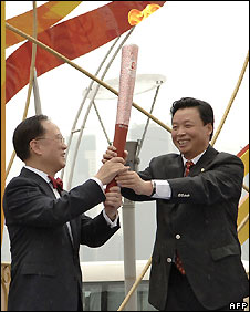HK's chief executive Donald Tsang (left) and Yang Shu-an, executive vice president of the Beijing Organizing Committee for the Games - 2/5/2008