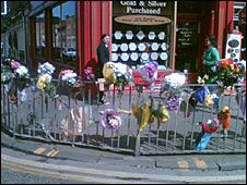 Floral tributes have been left at the spot where Mr Wilson was killed