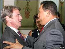 France's Foreign Minister Bernard Kouchner (L) hugs Venezuelan President Hugo Chavez