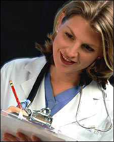 Female doctor holding clipboard and writing (Picture: EyeWire Inc)