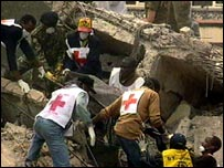 Emergency crews at the site of the US embassy in Nairobi after the 1998 bomb