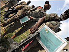 Ex-combatants of the New Forces wait with demobilisation certificates at the office of the re-grouping camp in Bouake (2 May 2008 )