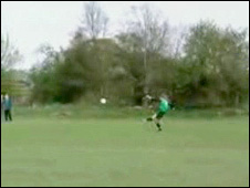 Goalkeeper Steve Goodwin lets fly from the edge of his penalty area