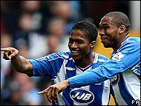 Antonio Valencia and Wilson Palacios celebrate Wigan's first goal
