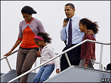 Barack Obama with his wife and daughters at Indianapolis international airport, 3 May 2008