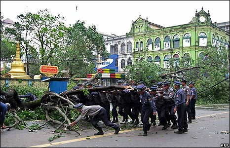 Police remove a fallen tree in Rangoon on 4 May