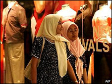 Malaysian women walk through a shopping mall in Kuala Lumpur (file photo)
