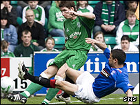 Hibs full-back Kevin McCann clears from Nacho Novo