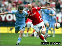 Jay Tabb of Coventry City battles for the ball with Jonjo Shelvey