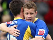 Paul Parry is congratulated by Joe Ledley after scoring the first goal