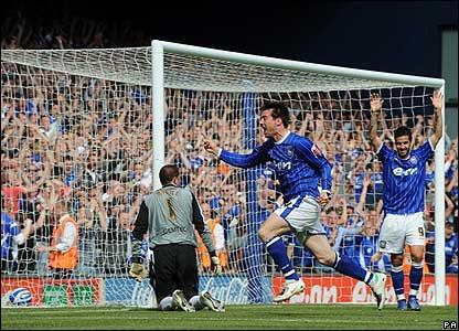 Lee celebrates his goal
