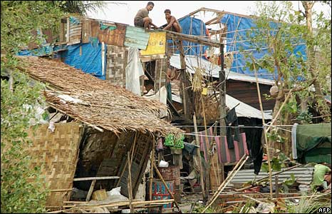 Residents rebuild their house after cyclone Nargis on the outskirts of Rangoon.