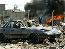 A car burns at the site of a US air strike in Sadr City, Baghdad, on 3 May 2008