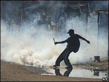 A man kicks away a gas canister fired by police during clashes over an autonomy referendum in Santa Cruz, Bolivia, 4 May 2008