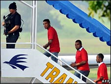 The men board the plane in Jakarta