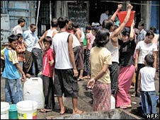 People queue to get drinking water in Rangoon on 5 May 2008