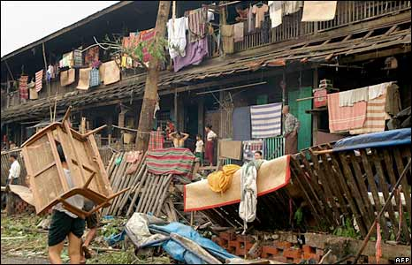 Residents rebuild their homes in Rangoon on 4 May 2008