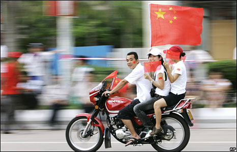 Chinese flags on a bike in Qionghai city