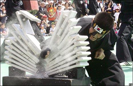 South Korean soldier smashes stone blocks in Seoul