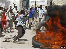 Somalis burn tyres and throw stones during a demonstration against record-high inflation, 5 May 2008