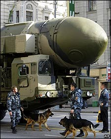 Police with sniffer dogs patrol near a Topol missile at the parade dress rehearsal on 5 May