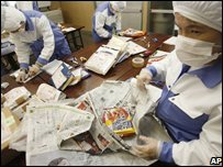 Japanese packers check recalled food - photo 1 February