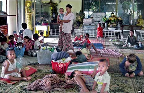 Rangoon residents who lost their homes take shelter in a Buddhist temple on 5 May 2008