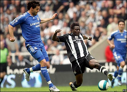 Ballack comes across to tackle Martins