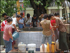Residents queue to get drinking water in Rangoon on May 5, 2008