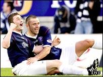 Falkirk defender Tam Scobbie celebrates his goal with team-mate Michael Higdon