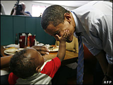 A young boy gently taps Barack Obama on the cheek in Greensboro, North Carolina, 5 May, 2008