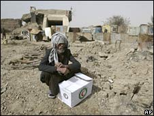 A displaced Iraqi man sits outside a former military complex where he lives with his family after receiving humanitarian aid in the Shiite enclave of Sadr City