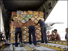 Aid workers load supplies onto a plane in Bangkok