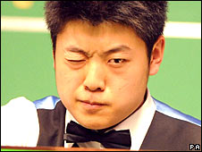 Liang Wenbo in action in the World Snooker Championships