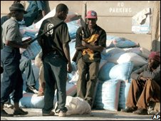 Police confiscate bags of salt for sale on the black market at Mbare, Harare.