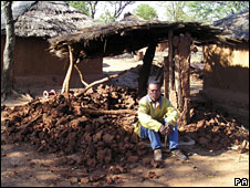 A farm labourer sitting on the remains of his demolished hut in Umguzaan Farm in Nyamandhlovu, north of Bulawayo, Zimbabwe, undated photo