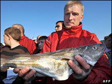 Fishermen holding cod. Image: AFP/Getty