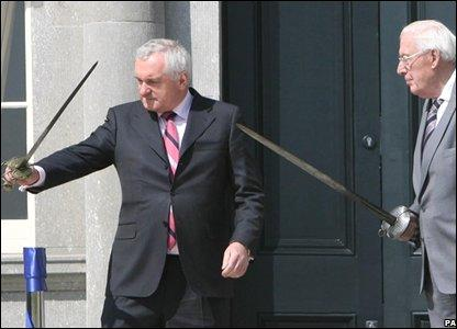 Bertie Ahern and Ian Paisley wield swords