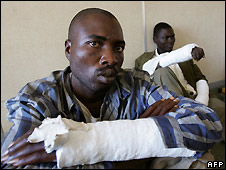 Two MDC supporters who say they were beaten by Mugabe supporters - 3/5/2008